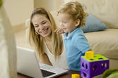 Young beautiful mother playing with her son — Stock Photo
