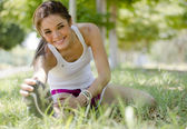 Young beautiful woman doing some stretching exercises at the park — Stock Photo