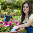 Girl plating some flowers — Stock Photo