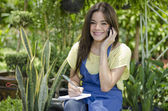 Young beautiful woman with mobile — Stock Photo