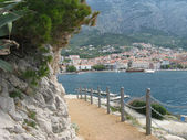 Sea, makarska, croatia, adriatic, town, dalmatia, mountain, travel, harbor, resort, water, coastline, architecture, building, landscape, tourism, nature, mediterranean, vessel, city, europe, summer, y — Stock Photo