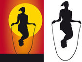 Silhouette girls jump rope — Stock Photo
