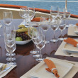 Dinner table on yacht — Stock Photo #11449768