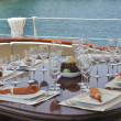 Dinner table on yacht — Stock Photo #11449783