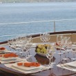 Dinner table on yacht — Stock Photo #11449819