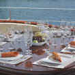 Dinner table on yacht — Stock Photo #11449840