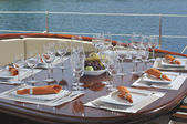 Dinner table on the yacht — Stock Photo
