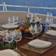 Dinner table on the yacht - Stock Photo