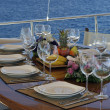 Dinner table on boat — Stock Photo #11450438
