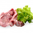 Fresh pork meat with lettuce leaves isolated on white background — Stock Photo