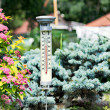 Modern stylish outdoor thermometer in the garden — Stock Photo