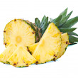 Ripe pineapple with slices  isolated on white background — Stock Photo