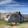 Upturned Boat sheds - Stock Photo