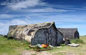 Upturned Boat sheds — Stock Photo