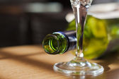 Wine bottle and glass — Stock Photo