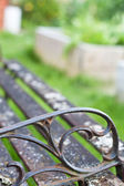 Antique garden bench — Stock Photo
