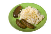 Mashed potatoes with pickles on a plate — Stock Photo
