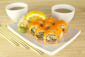 Set of sushi with teacups — Stock Photo