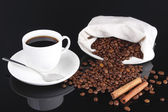 Cup of coffee and coffee beans from bag — Stock Photo