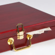 Red wooden box is open and money - Stock Photo