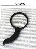 Magnifier on News — Stockfoto