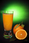 Natural orange juice, art background — Stock Photo