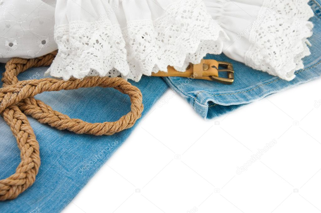 Jeans background with a lacy blouse and a leather belt — Stock Photo #11434251