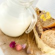 Jug with milk, bread and wild flower — Stock Photo