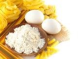 Crude yellow macaroni in — Stock Photo