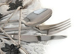 Table fork and knife in a napkin — Stock Photo