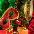 Christmas card. Champagne, a branch of a fur-tree, a candle and a carnival mask — Stockfoto