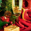 Christmas card. Champagne, a branch of a fur-tree, a candle and a carnival mask - Stock Photo