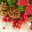 Christmas red tape and branch of berries and fur-tree - Foto Stock