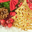 Christmas branch of berries with a gold fur-tree against snow — Stock Photo #11459517