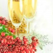 Christmas champagne and branch of berries with a fur-tree — Stock Photo #11459636