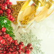 Christmas champagne and branch of berries with a fur-tree — Stock Photo #11459638