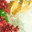 Christmas champagne and branch of berries with a fur-tree - Stock Photo