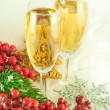 Christmas champagne and branch of berries with a fur-tree — Stock Photo