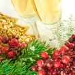 Christmas champagne and branch of berries with a fur-tree — Stock Photo #11459647