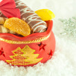 Christmas bag with gifts, cookies and fruit candy, a gift — Stock Photo