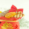 Stock Photo: Christmas bag with gifts, cookies and fruit candy, a gift