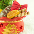 Christmas bag with gifts, cookies and fruit candy, a fur-tree branch - Stock Photo