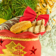 Stock Photo: Christmas bag with gifts, cookies and fruit candy, a fur-tree branch