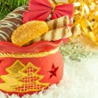 Christmas bag with gifts, cookies and fruit candy, a fur-tree branch — Stock Photo #11459786