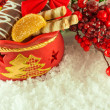 Christmas bag with gifts, cookies and fruit candy, a fur-tree branch — Stock Photo
