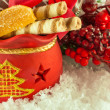 Christmas bag with gifts, cookies and fruit candy, a fur-tree branch — Photo