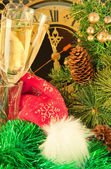 Christmas card. New Year's mask against fur-tree branches with cones — Stock Photo