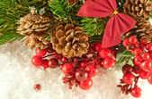 Christmas red tape and branch of berries and fur-tree — Stock Photo