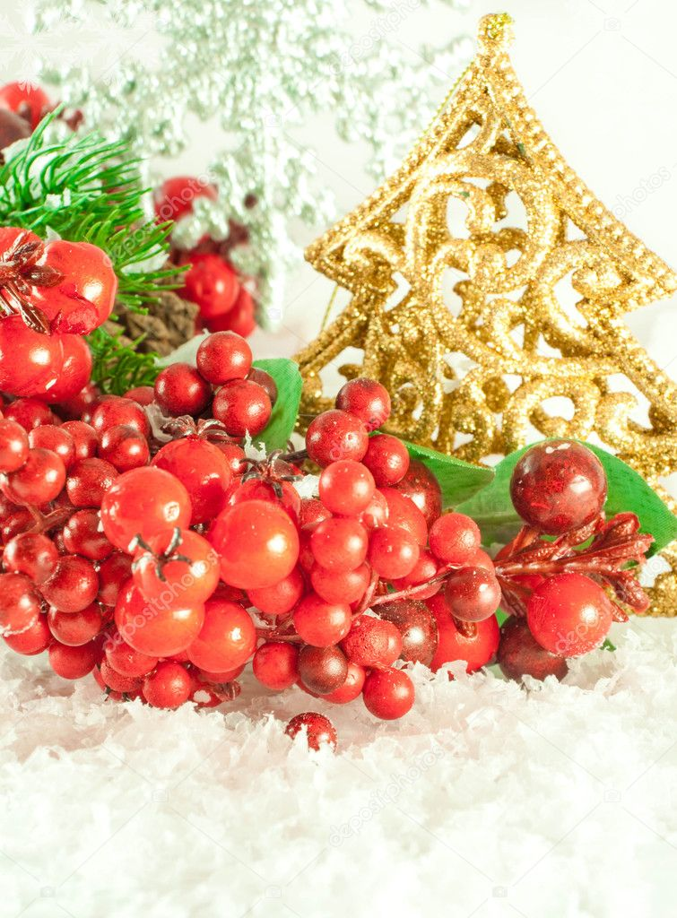 Christmas branch of berries with a gold fur-tree against snow  Stock Photo #11459452