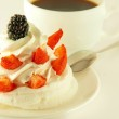 Cake from cream, strawberries and blackberries, a cup of fragrant coffee — Stock Photo